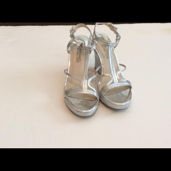 3d6a48684b2 Michael Kors Metallic Silver Wedge Heel Sandals. M 5b5d20e425457ad7003f4222
